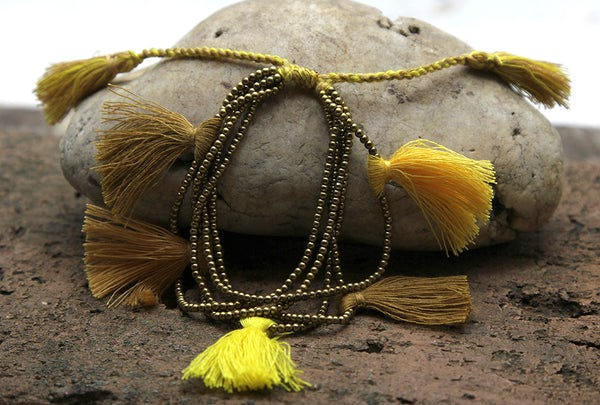 Fair Trade Hand Made Gold Color Beads With Yellow Tassels